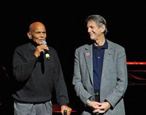 """NEW YORK, NY - DECEMBER 14: Harry Belafonte and Peter Coyote performs at the """"Bring Leonard Peltier Home 2012"""" Concert at The Beacon Theatre on December 14, 2012 in New York City. (Photo by Bobby Bank/WireImage)"""